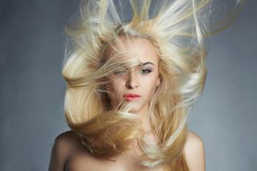 young beautiful woman.Sexy blond girl.Beautiful healthy hair