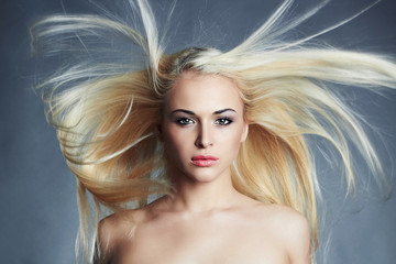 young beautiful woman.Sexy blond girl.Beauty salon haircare