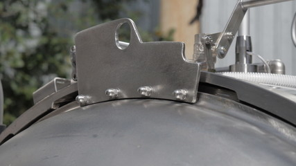 Opening  lid of the autoclave