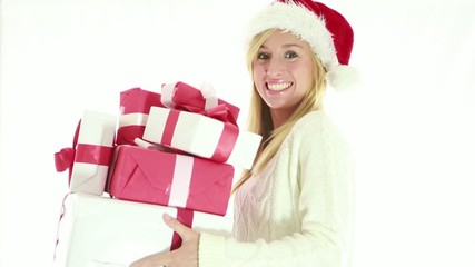 Cheerful young woman holding Christmas presents
