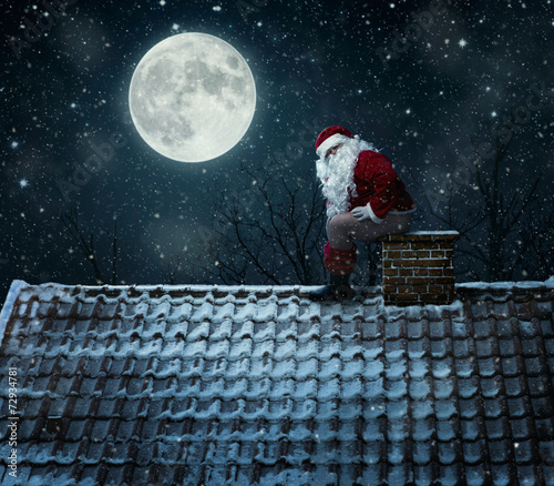 Leinwanddruck Bild Close up of mean santa using chimney as a toilet