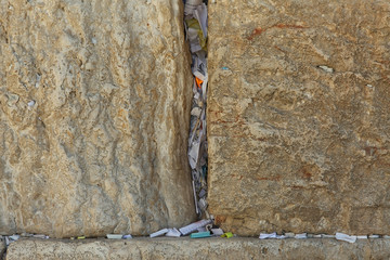 Stones of the wailing wall in Jerusalem with notes