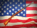 The Hawken rifle on american flag. Rifle from 19th century.