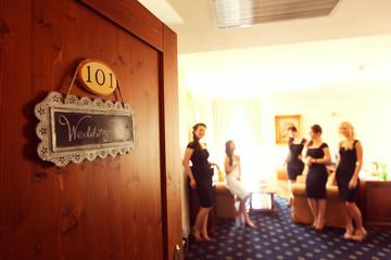 bride dressing room preparing for her wedding other women