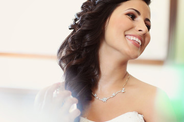 Beautiful bride to be applying make up happy smile wedding