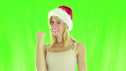 Happy cheerful woman dressed with santa hat