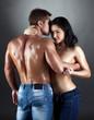 Image of attractive lovers embracing in studio