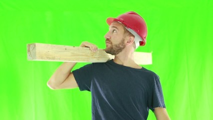 Proud construction worker, isolated on green