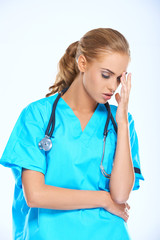Stressed nurse or doctor with a headache