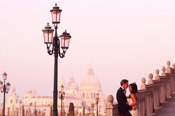 Beautiful wedding couple in Venice on their honeymoon