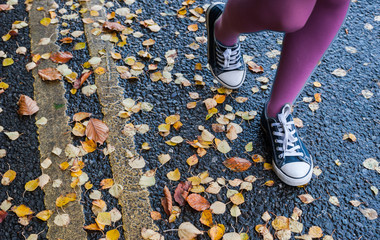 walking by autumn leaves yellow street lines