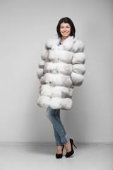 beautiful woman model in fur coat