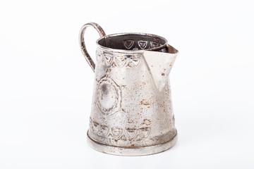Old coffee pot without cover with spots of rust on a white backg