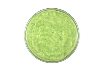 grated horseradish sauce with green in glass containers