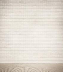 Grey brick wall texture with walkway.