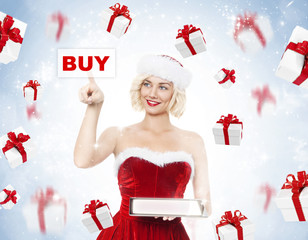 Beautiful young blond woman as santa girl