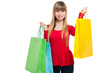 Young woman holding shopping bags isolated on white