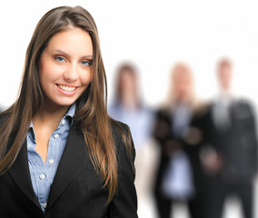 Portrait of a female manager in front of her team