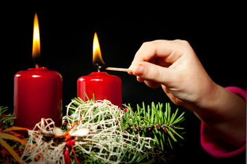 Lightning the candles on advent wreath