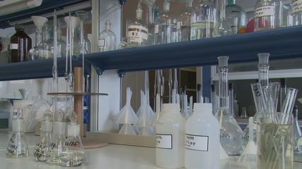 Scientific laboratory. Bottles, jars, flasks, test tubes.