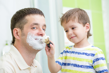 preschooler watching shaving of his dad
