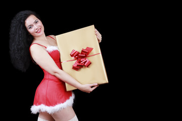 Christmas sensual brunette girl with gift box, isolated
