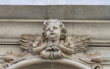 cherub ancient sculpture on the wall of Pisa