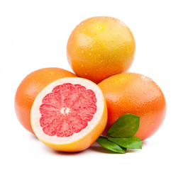 three grapefruit and slice with leaves isolated