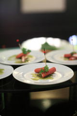Sausages canape with pesto sauce