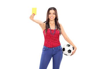 Female football fan showing a yellow card