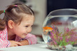 cute little girl and goldfish