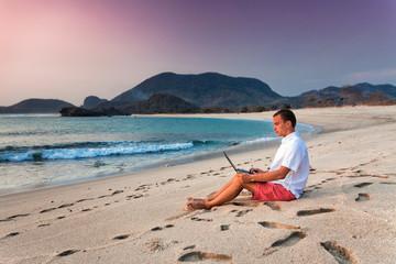 man uses laptop remotely