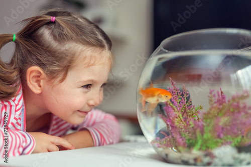 canvas print picture cute little girl and goldfish