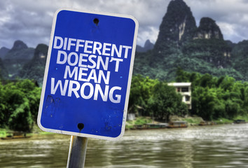Different Doesn't Mean Wrong sign with a exotic background