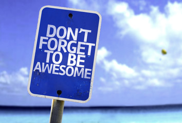 Don't Forget to Be Awesome sign with a beach on background