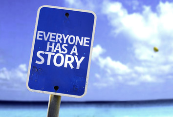 Everyone Has a Story sign with a beach on background