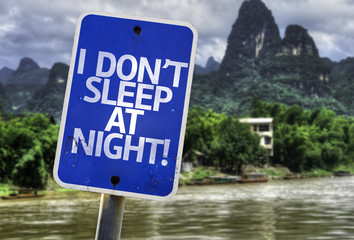 I Don't Sleep At Night sign with a exotic background