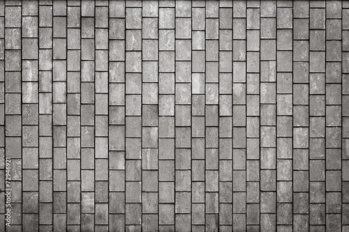 Facing gray tiles as a vintage background - 72946921