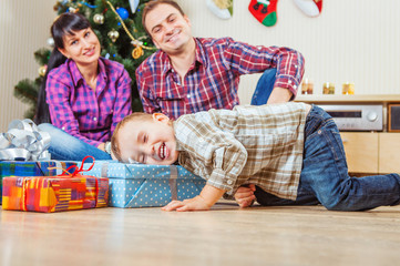 Little boy finds a Christmas presents under the tree