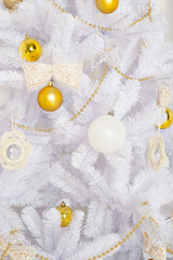 Fashion Christmas tree, white with gold balls, close-up