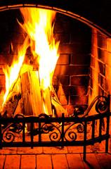 Burning Fireplace. Chimney and woodpile. Chimney place. Christma