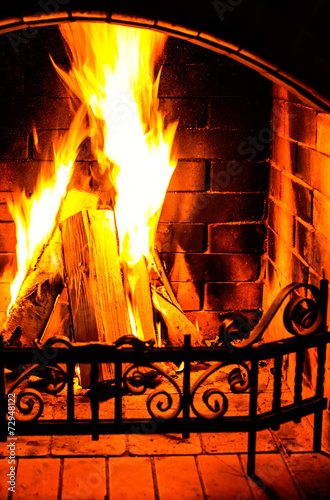 canvas print picture Burning Fireplace. Chimney and woodpile. Chimney place. Christma