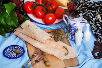 Italian thin pita bread on a board still life