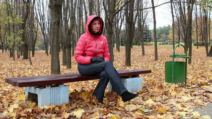 girl with a phone in the park. autumn park