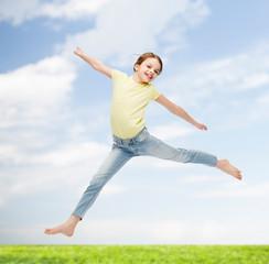 smiling little girl jumping