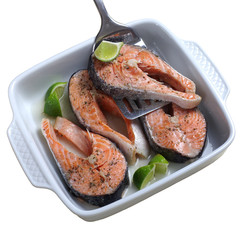 Salmon baked with white wine on a white background