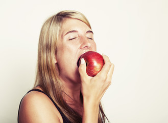 Woman biting into apple
