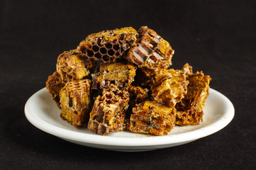 Pile of bee pollen or bee bread on the black background