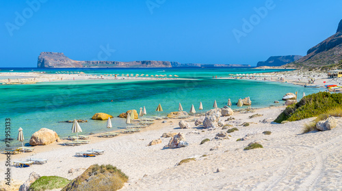 Umbrellas on Balos beach on Crete island, Greece - 72953133