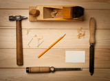 joinery tools on wood table background with business card poster